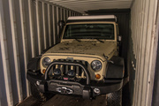 The Jeep locked and loaded into the 20 foot shipping container. It's got about 6 inches all round.